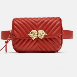 CROSSBODY BELT BAG WITH LIONS DETAIL